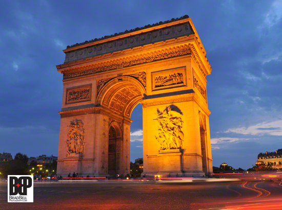 The Arc de Triomphe at twilight.