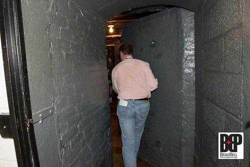 Behind the hidden door is the infamous cellar, home to 20,000 cases of wine.